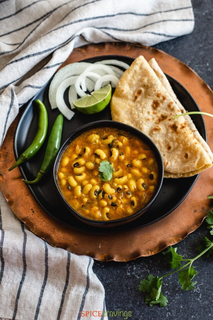 Black eyed peas curry with roti, onions and chili