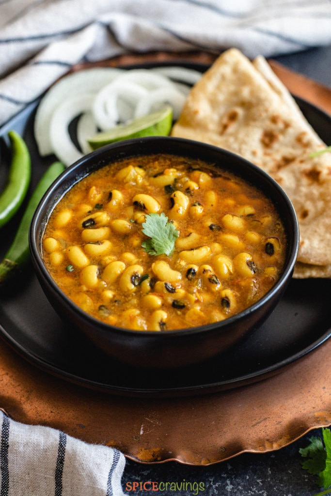 Indian style black eyed peas curry, lobia in a black bowl