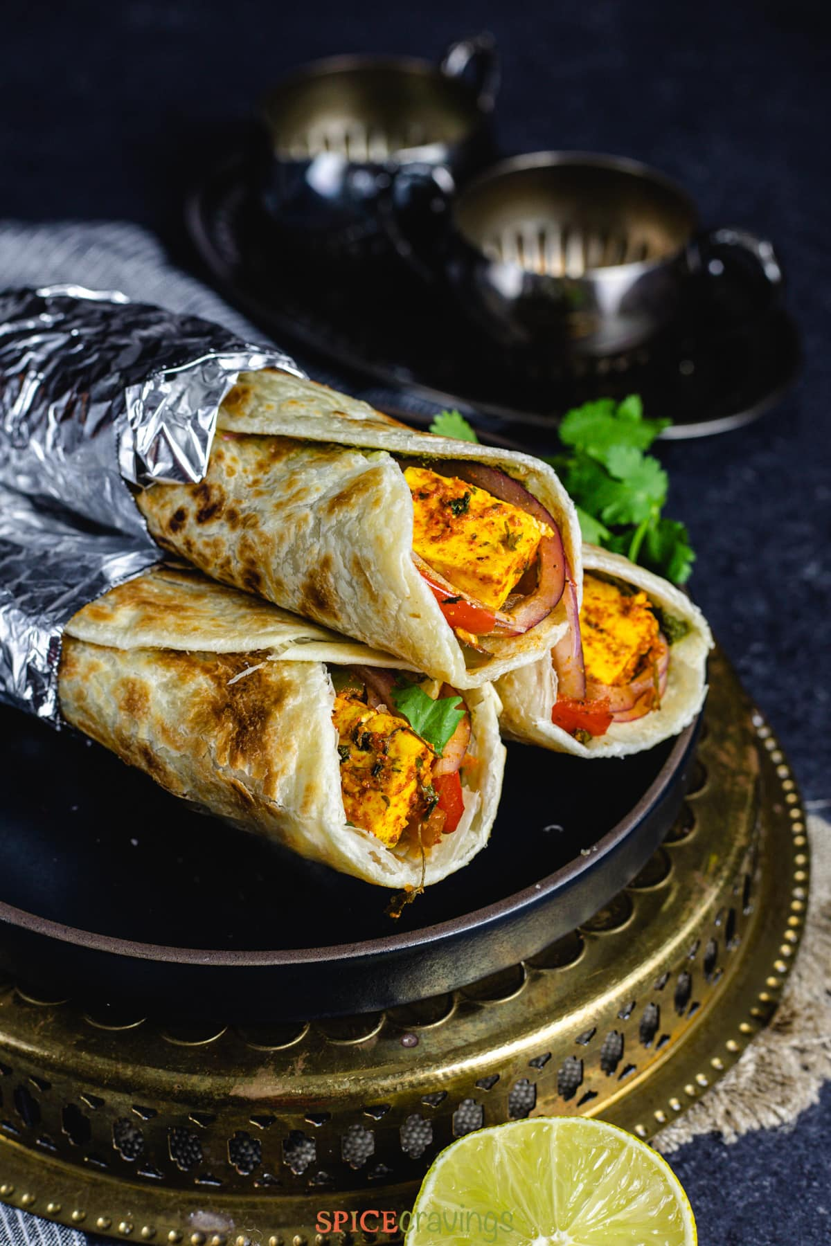 Stack of Paneer Kathi Rolls on a plate
