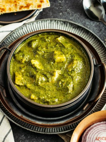 Indian spinach potato curry in a metal plate