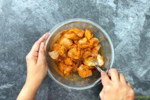 Tossing chicken in yogurt marinade