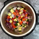 Chopped vegetables inside of an Instant Pot