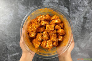 Marinating paneer in a glass bowl