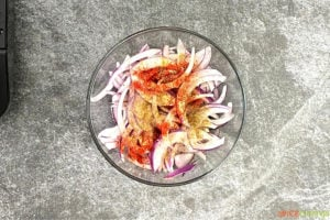 Vegetables and spices in a glass bowl