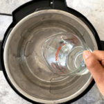 Water being poured into a pressure cooker
