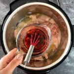 Kung Pao sauce being poured into an Instant Pot