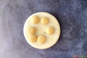Round dough balls on a marble surface