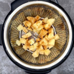 Spiced Potatoes in a steamer basket