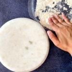 Dusting roti dough in dry flour