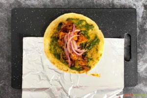 A paratha filled with veggies and chicken