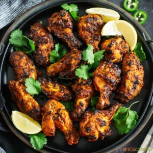 A tray of tandoori chicken wings