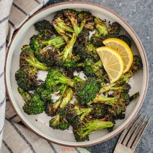 roasted broccoli served with lemon slices