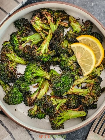 roasted broccoli served with lemon slices