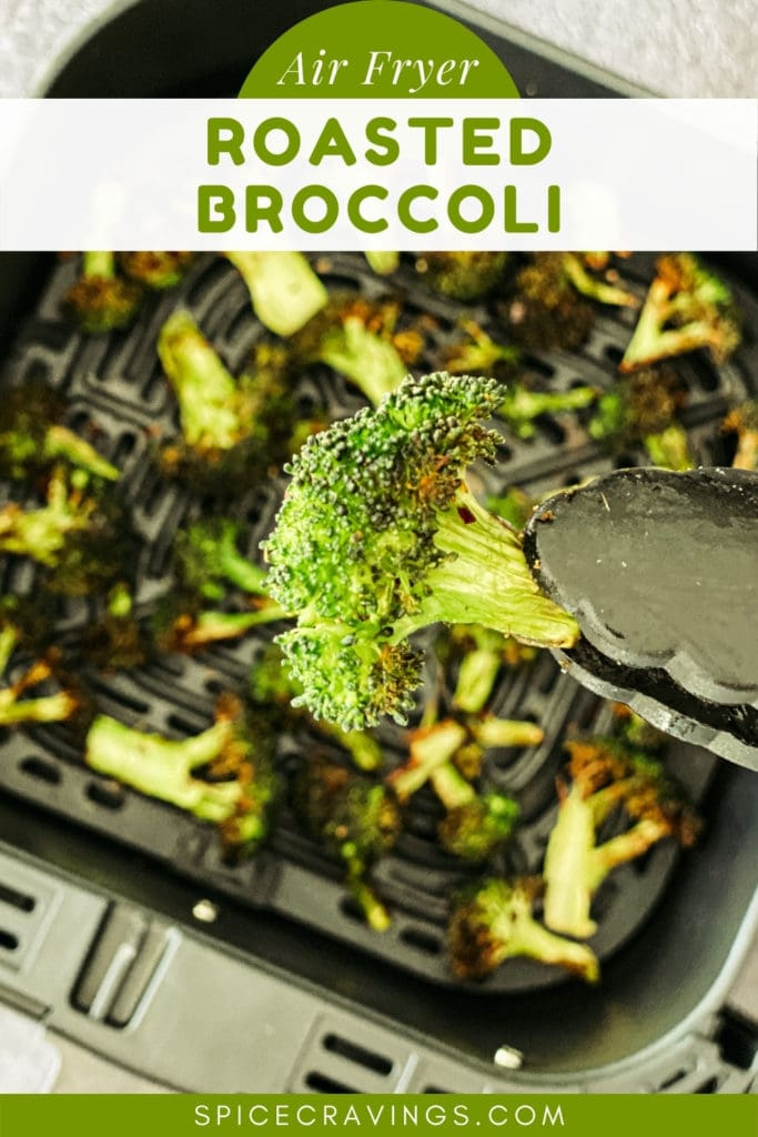 Lifting a roasted broccoli floret with tongs