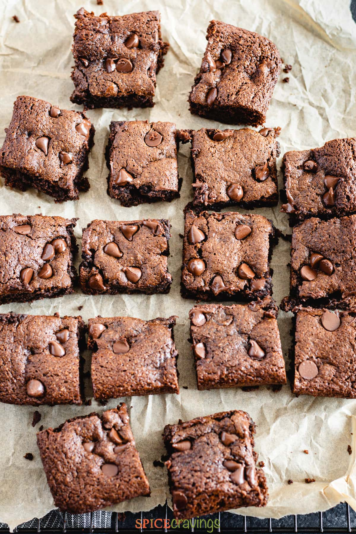 Squares of almond flour brownies on parchment paper