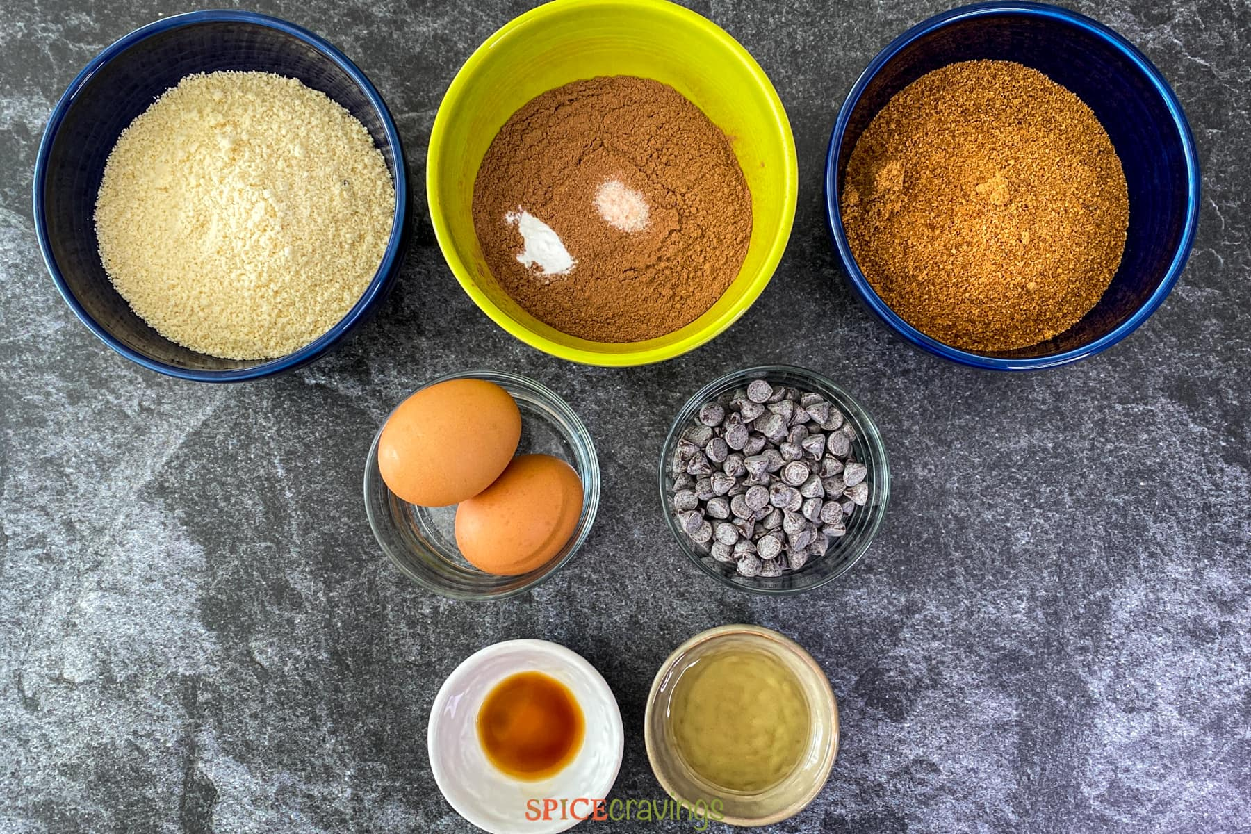 Ingredients for almond free brownies in bowls on a counter