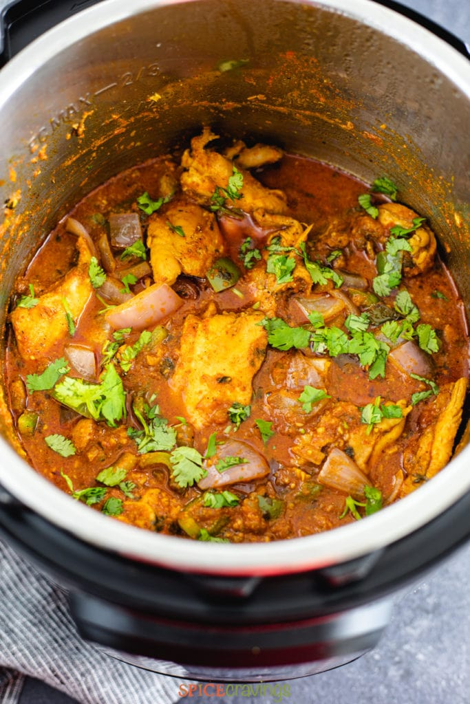 Indian chicken curry in instant pot garnished with cilantro