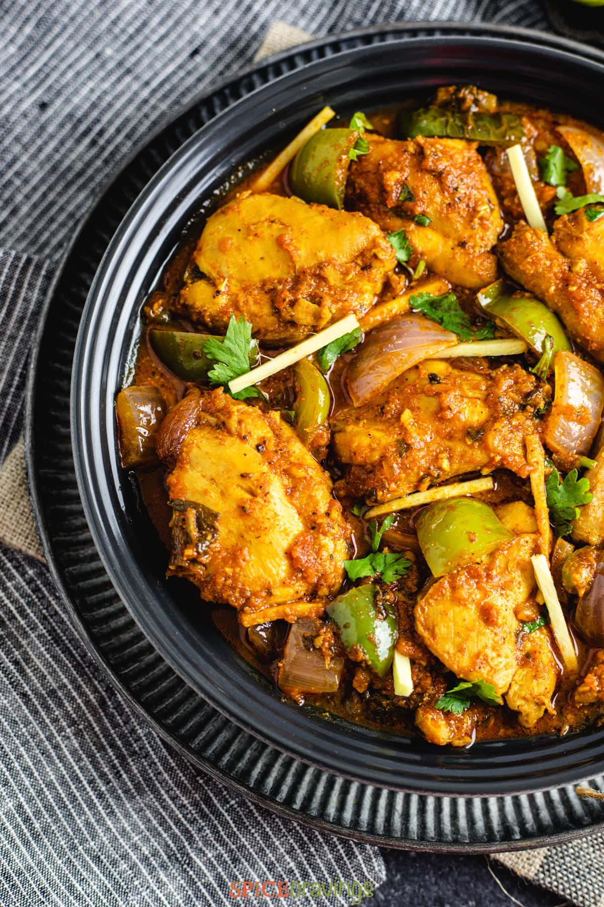 Kadai Chicken in a black bowl