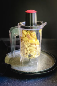Blender jar with chunks of ginger and garlic