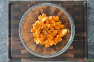 Uncooked sweet potato cubes in a bowl