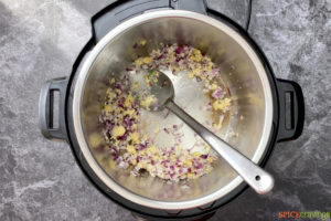 Aromatics and vegetables cooking in pressure cooker