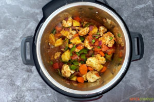 Vegetables, water and spices in instant pot