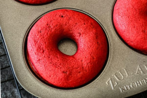 Baked red velvet donut in a baking tin