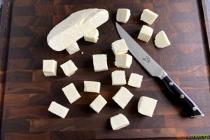 Chopped paneer on a cutting board
