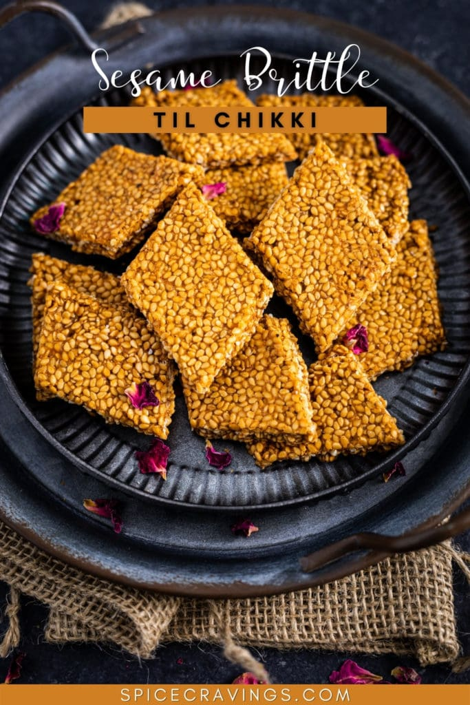 sesame brittle triangles on a metal plate