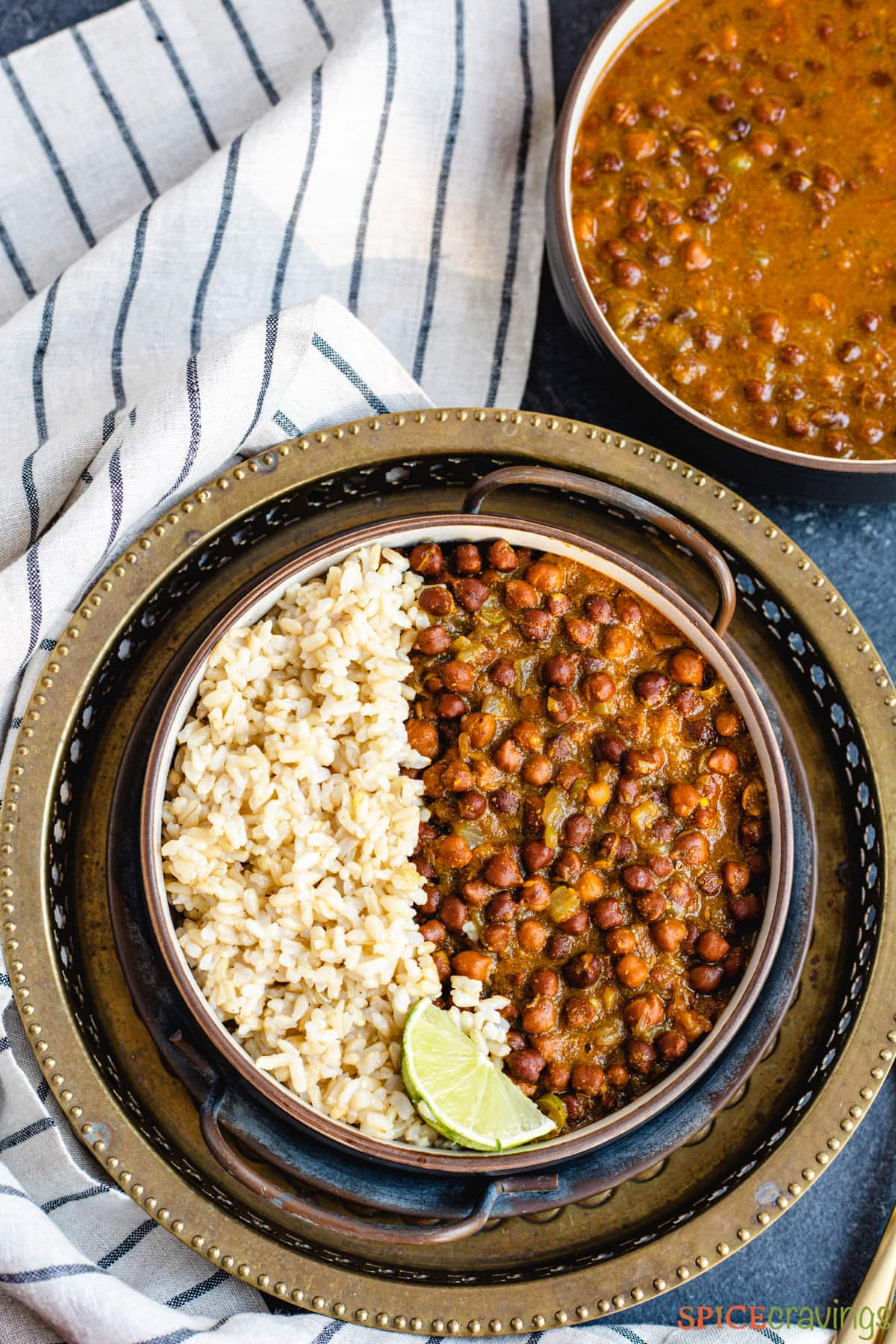 Black chickpea curry and rice in a black bowl