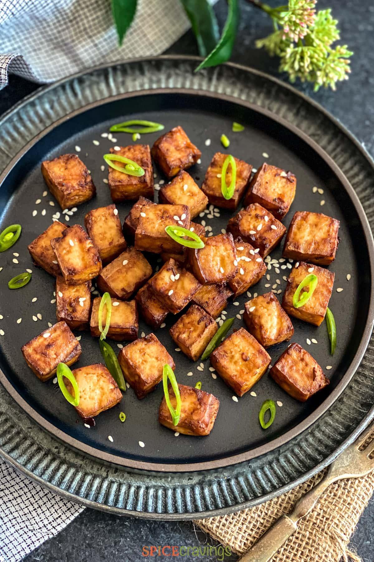 Air Fried Tofu on a black plate