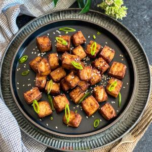 Air Fryer Tofu on a black plate