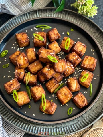 Air Fryer Tofu on a black plate
