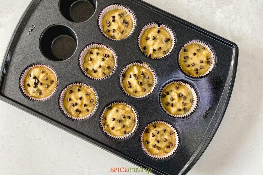 almond flour banana muffins batter in muffin tin