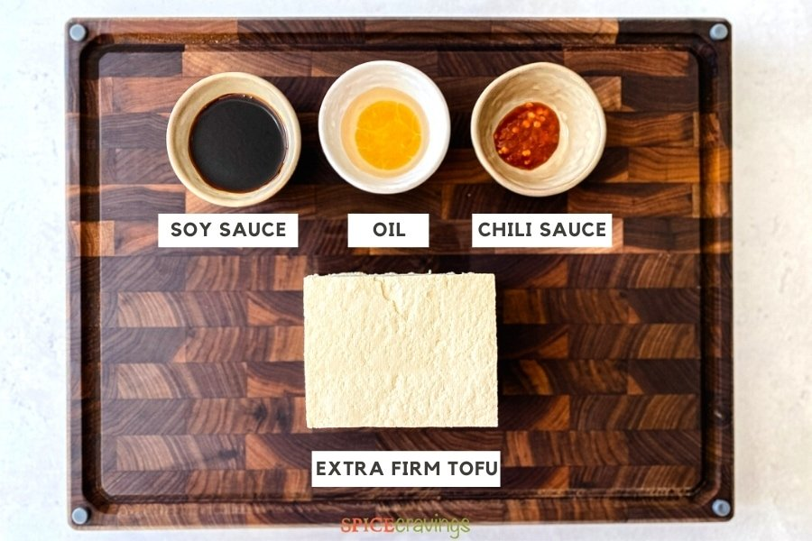 Ingredients for Crispy Air Fryer Tofu on a wooden cutting board
