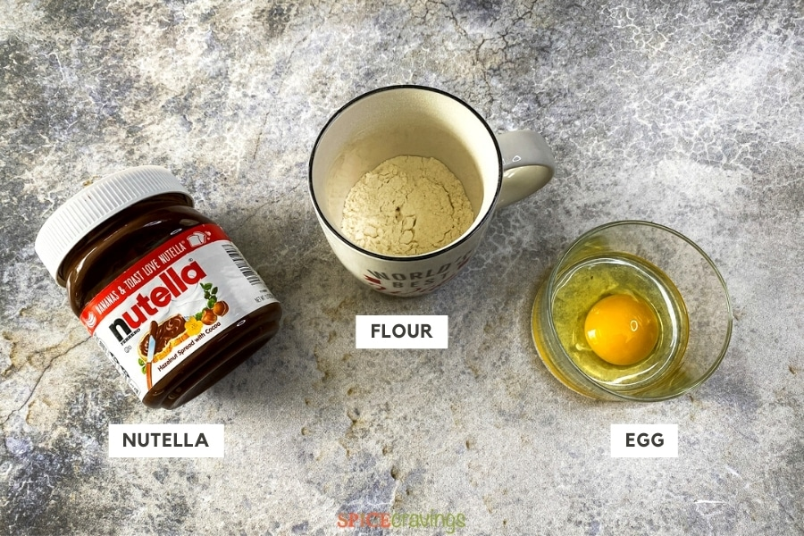 Ingredients for Nutella Mug Cake on a counter