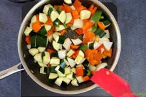 Sauteing vegetables in a skillet