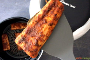 Air fried fish fillet on a spatula
