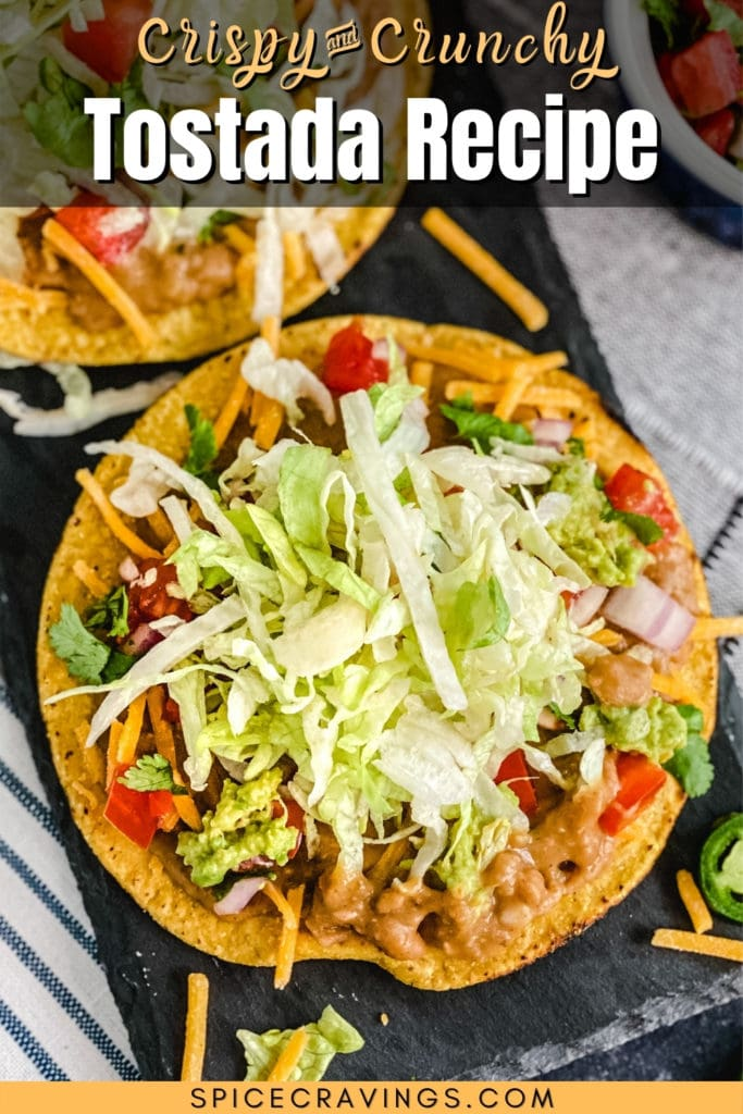 Tostada topped with beans, tomato, cilantro and lettuce
