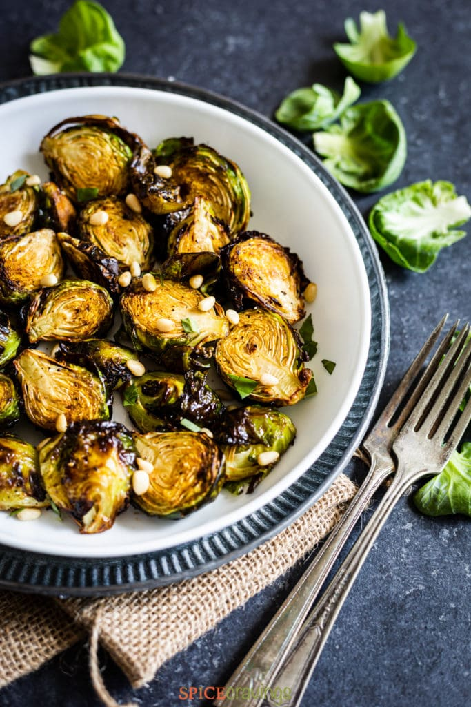 Air fried brussel sprouts in bowl close up shot