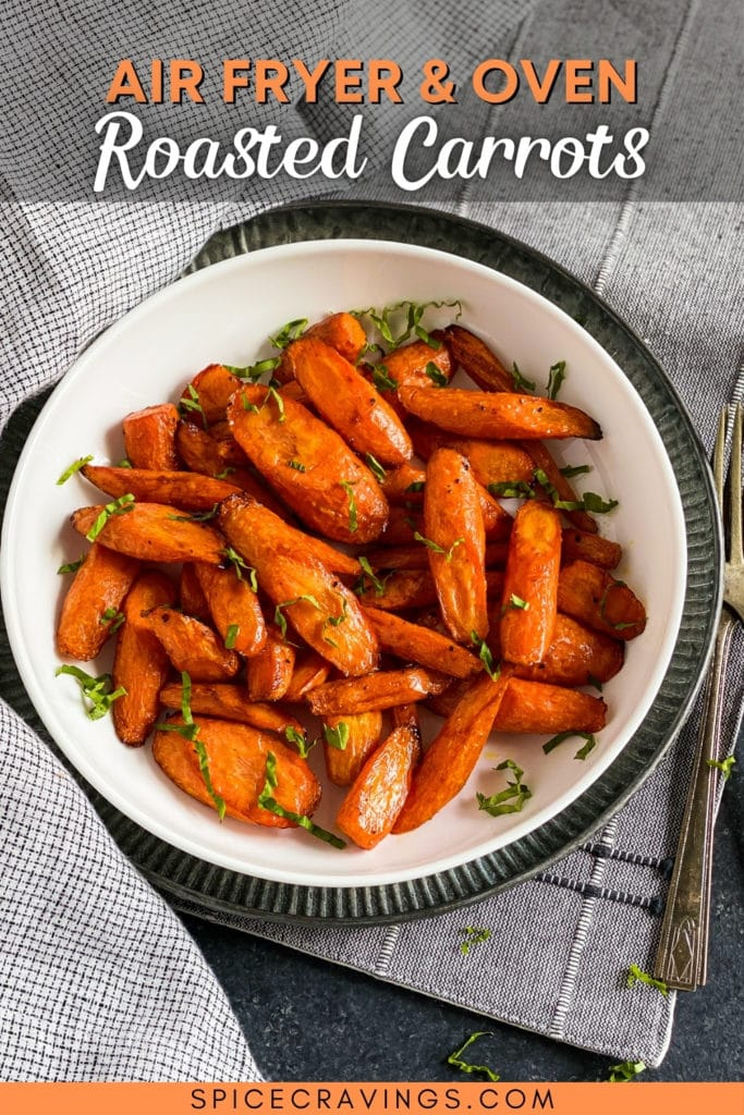 Cooked carrots in bowl with garnish