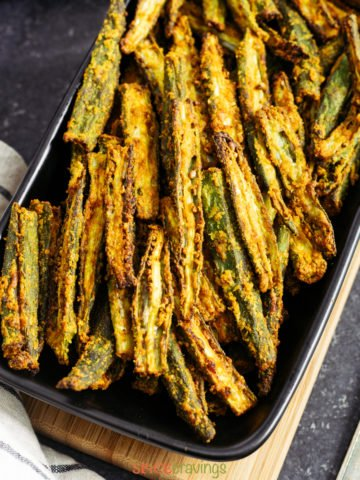 crispy okra on black serving platter