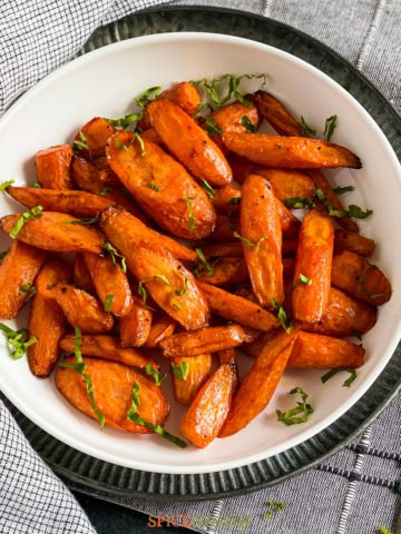 Air Fryer carrots in bowl with garnish close up shot