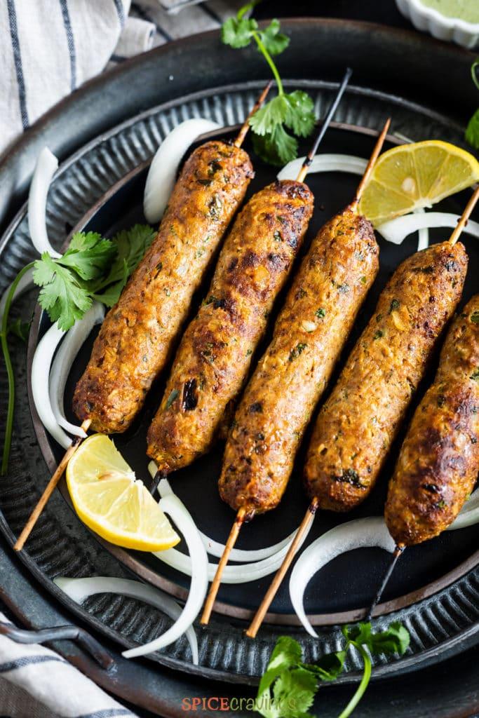 Skewers on chicken kebab on metal plates