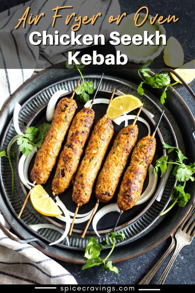 Chicken kebab skewers on metal plates