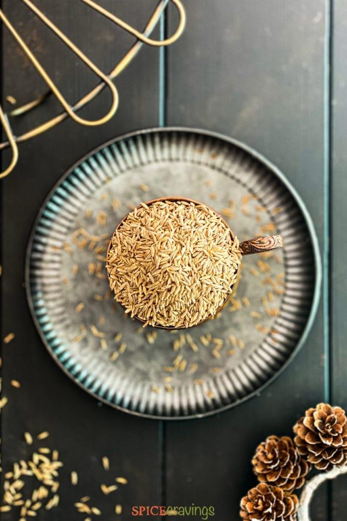 cumin seeds in metal bowl