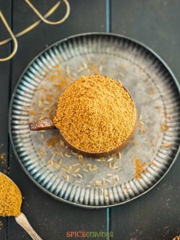 cumin powder in bowl on plate