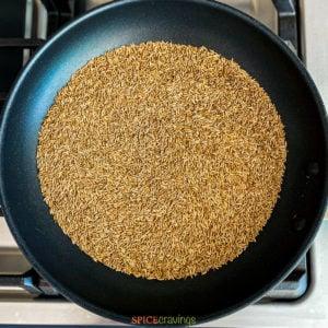 cumin seeds in skillet