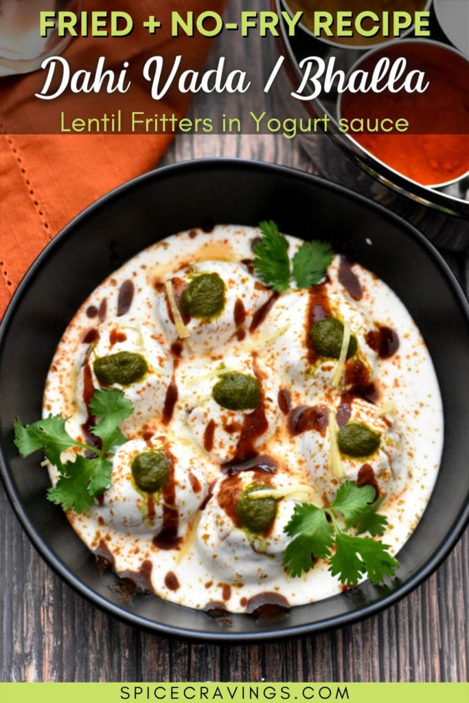 Bowl with dahi dhalla topped with tamarind and cilantro chutney and cilantro sprig
