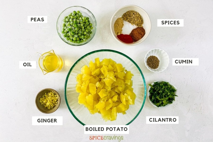 potatoes, ginger, oil, peas, Indian spices, cumin seeds, cilantro